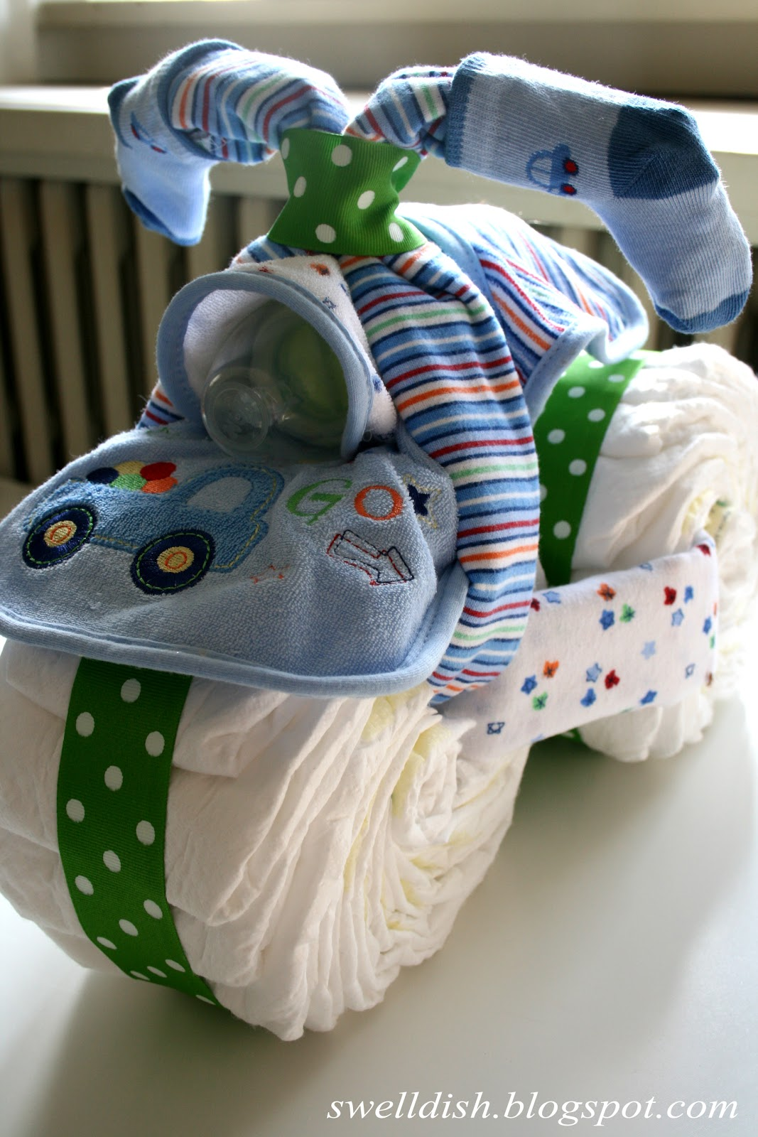 The swell dish the diaper tricycle so long diaper cakes for Diaper crafts for baby shower
