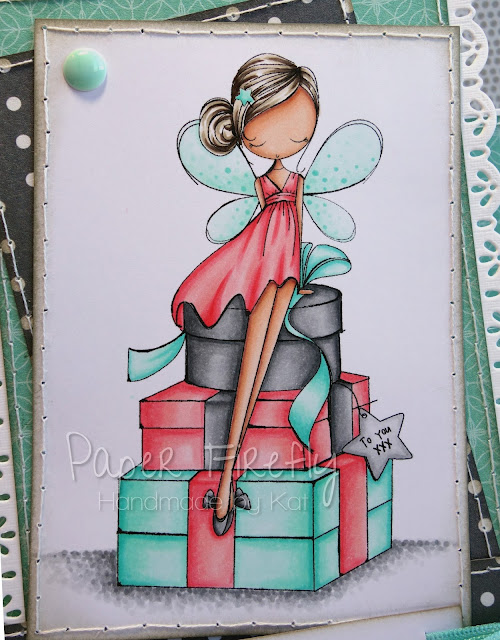 Stepper card featuring fairy with a pile of presents (image from ADU)