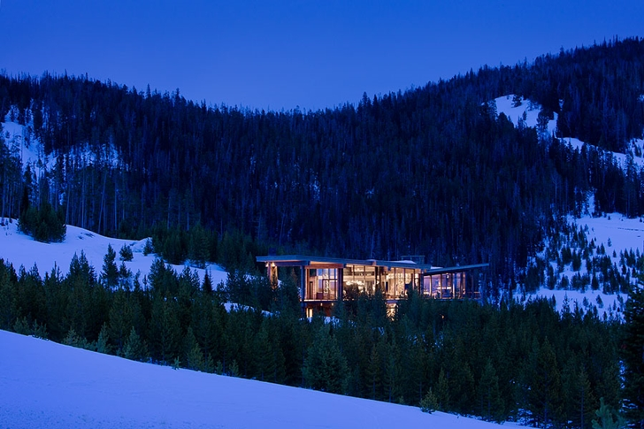 Elegant Mountain Home by Reid Smith Architects at night