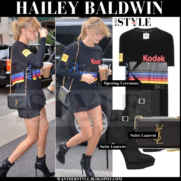 Hailey Baldwin in black Kodak logo tee, mini skirt and black platform ankle boots streetstyle models off duty 2015