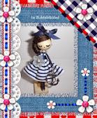 Doll brooch