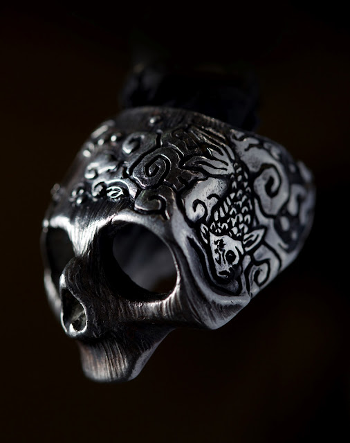 Intricate detail on a silver skull ring from 13 lucky monkey