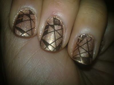 Gold and black stamping nail art