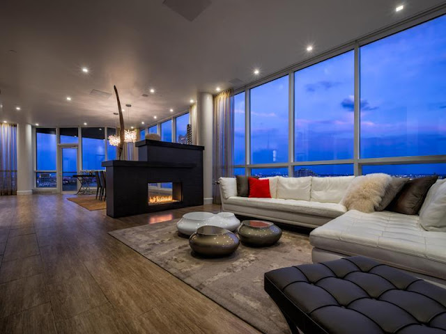 Photo of living room with modern fireplace in Philadelphia penthouse