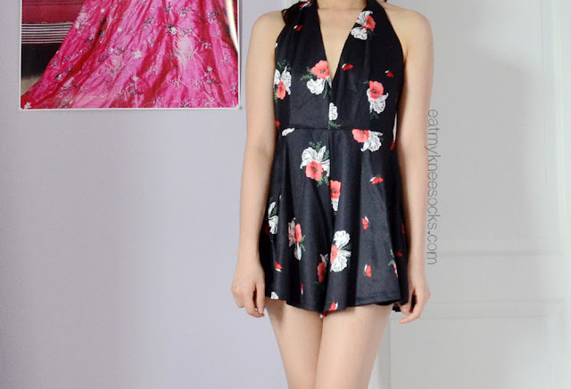 SheInside's floral halter romper is a dupe of the Free People Smooth Talker Romper, but with a smoother fabric and altered fit.