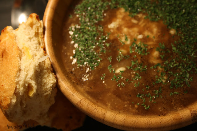 French onion soup with parsley, Swis cheese and cheesy crusty roll.