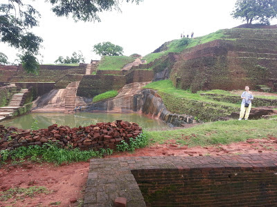 View on magnificent Granite Pool wholly carved, rock, foot of pyramid, summit, ancient, Sigiriya, history mysteries