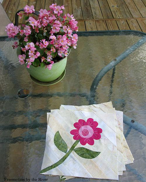 Pink appliqued flower on the deck