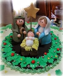fondant creation of Mary and Joseph standing by the boychild Jesus