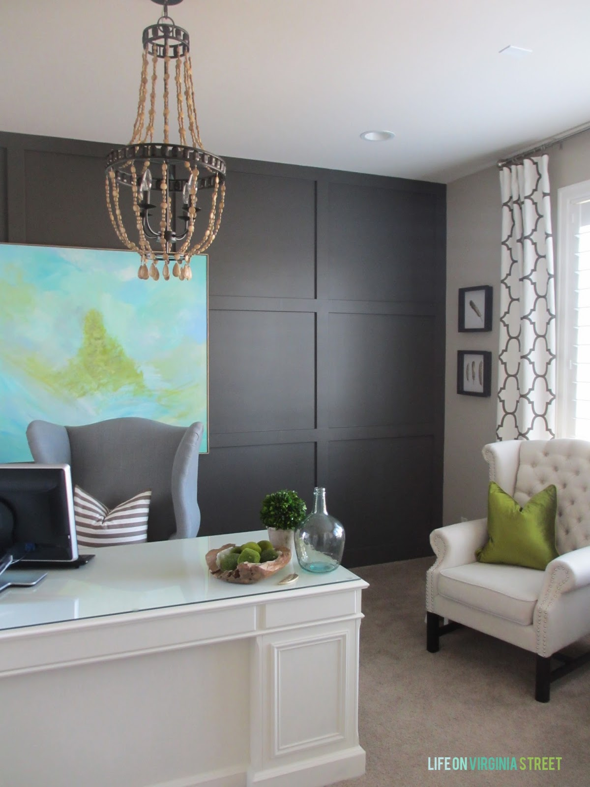 Home office makeover with Sherwin Williams Urbane Bronze board and batten wall, wood bead chandelier, and DIY abstract artwork.
