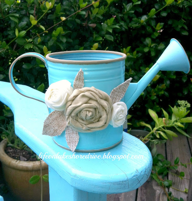 "alt=""Krylon spray paint watering can makeover with fabric rosettes"""