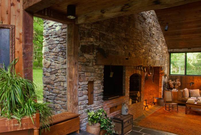 Estilo rustico paredes de piedra for Piedra para muros interiores