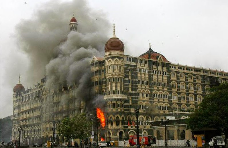 The Taj Mahal Hotel burning after the terrorist attacks in Mumbai
