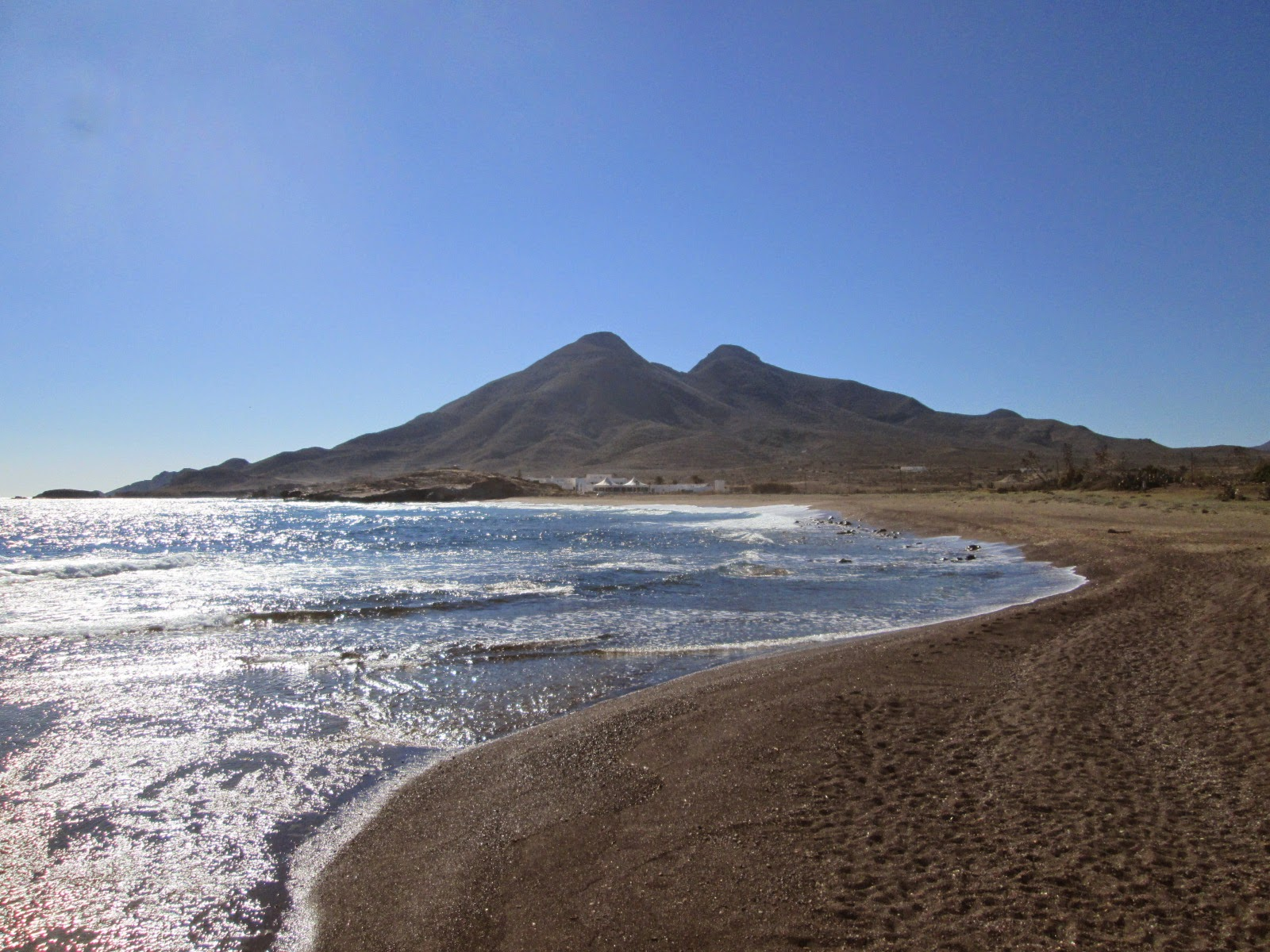 Looking back along Playa del Arco to El Frailes