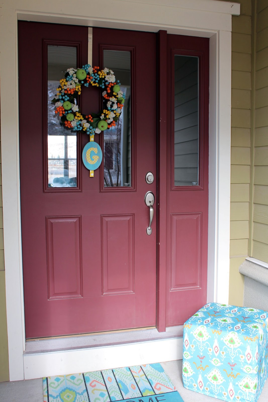 Worth pinning changing the color of the front door i re did my current wreath with bright springsummer colors and added an ikat pouf from one kings lane and new door mat from the threshold collection at rubansaba