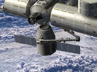 Dragon at the ISS (artist's impression)