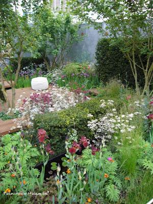 Tuindesign 20 tips en tuinidee n voor een kleine tuin met for Foto s voortuinen