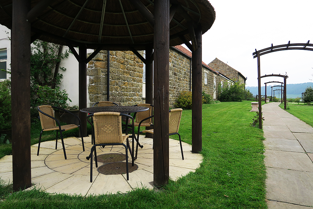 Outdoor seating area at Ox Pasture Hall