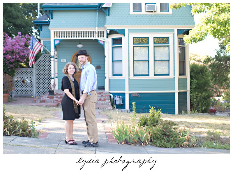 Bride and groom in front of a cottage at lifestyle engagement portraits in the Bay Area of California