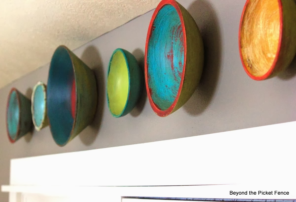Fabulous and vibrant wooden bowl wall art by Beyond the Picket Fence, featured on http://www.ilovethatjunk.com