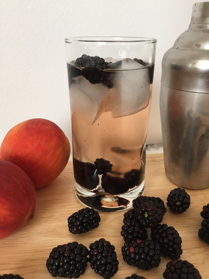 A blackberry peach cocktail made with IngeniOz vodka to represent the beautiful state of Iowa