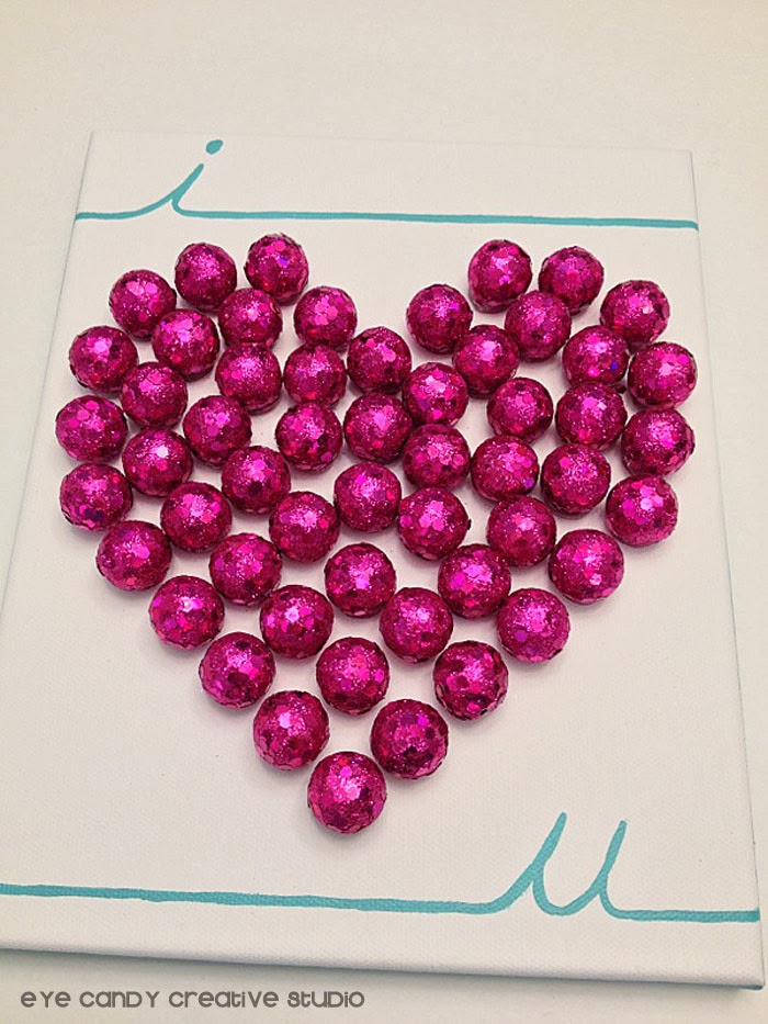 hot glue, pink scatters from hobby lobby, i love you art, heart shaped