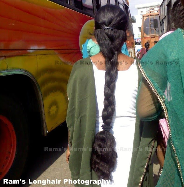 long hair college girl walking in bus stand.