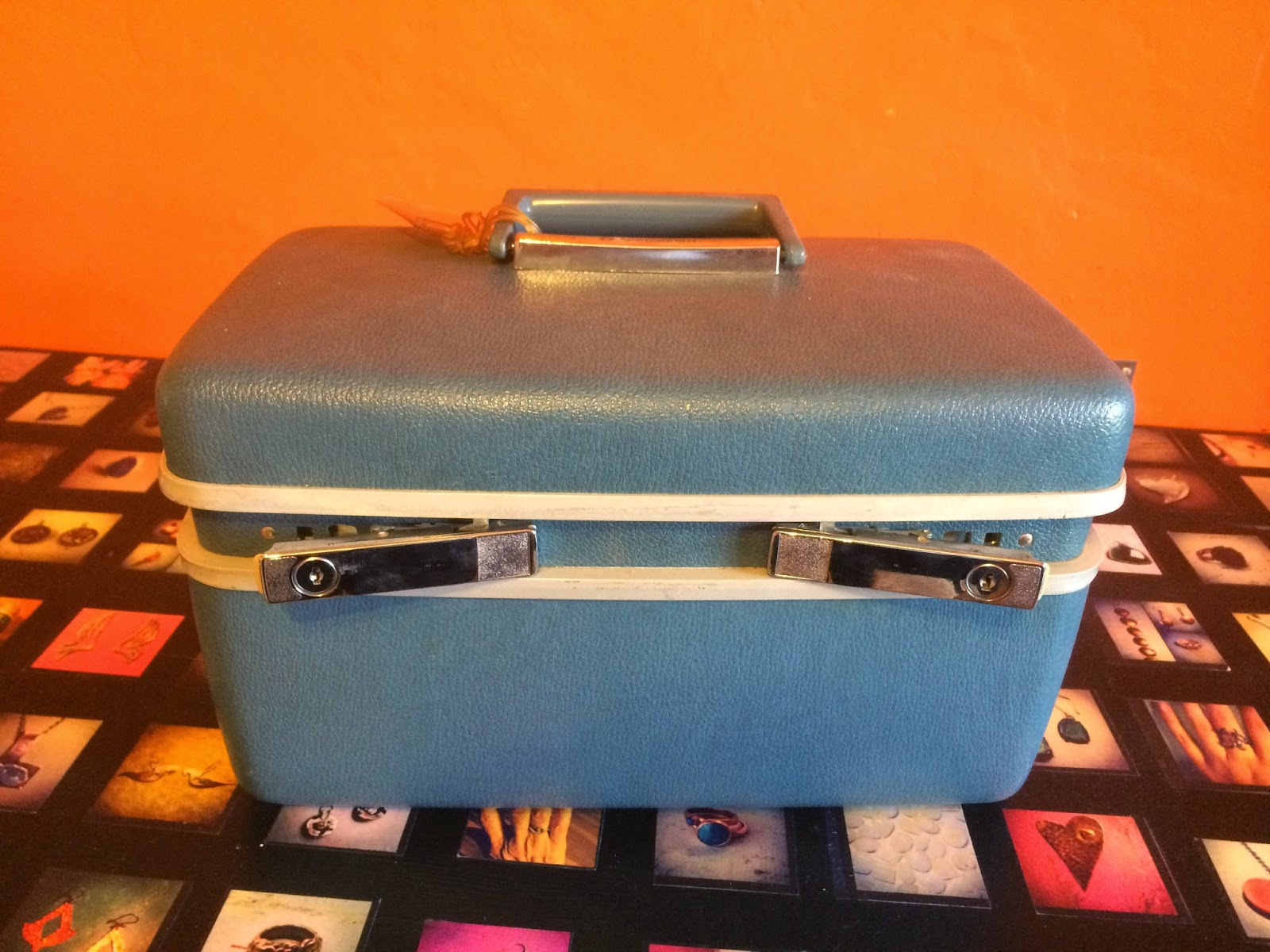 Blue vintage luggage case used as a toolbox for keeping jewelry supplies and tools in.