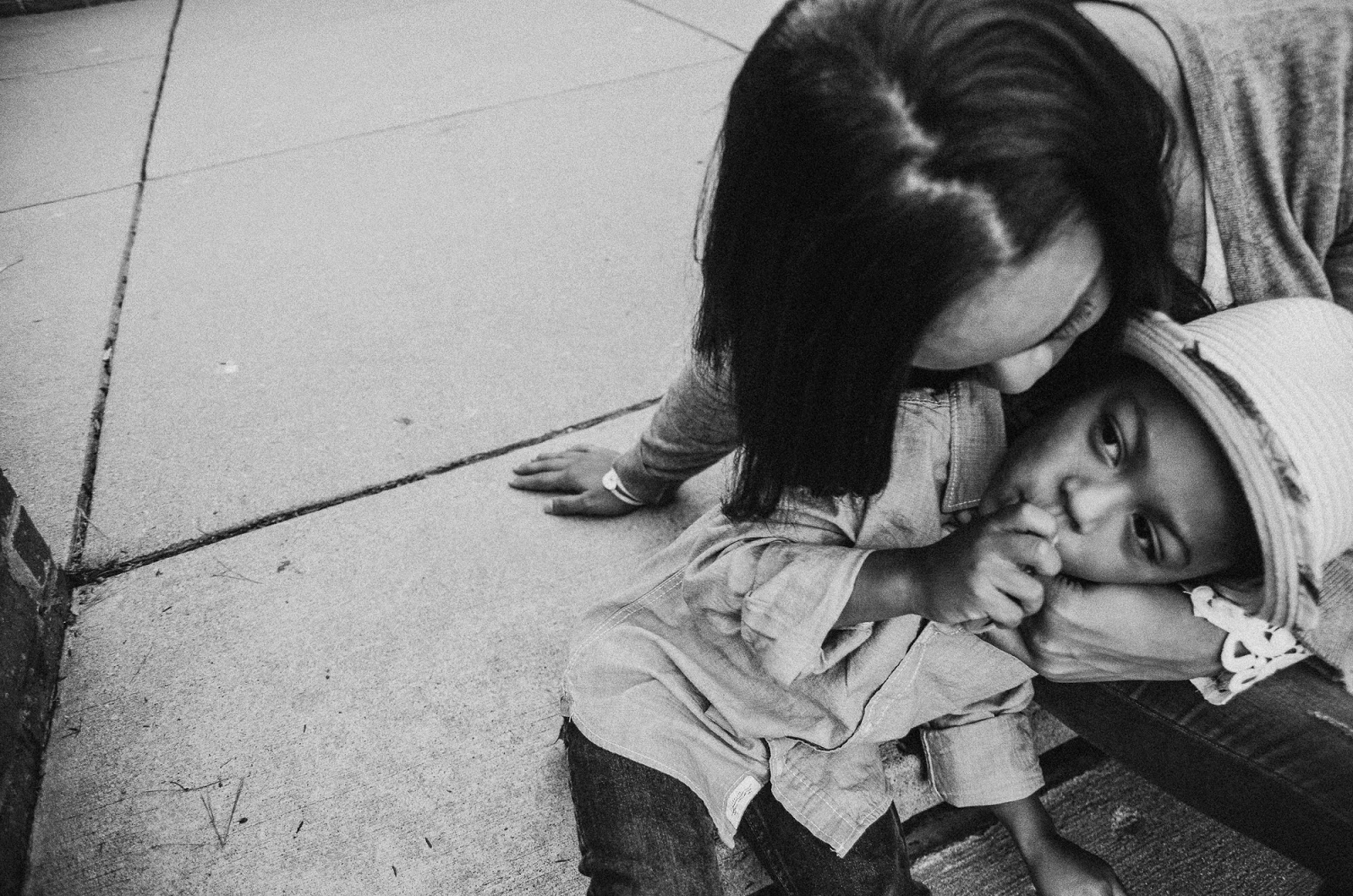 black and white photos of mom giving son kisses, indianapolis