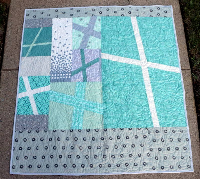 http://quiltyhabit.blogspot.com/2015/07/mint-and-gray-baby-quilt.html