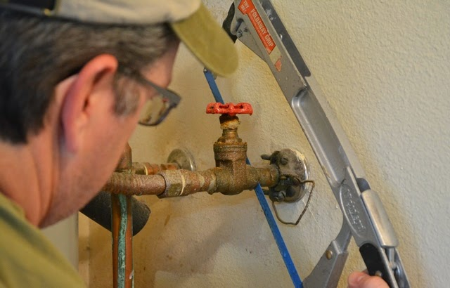 Cutting plumbing pipe with a hacksaw