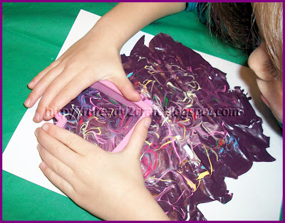 Creating shapes out of the paint skin for Valentine's Day Craft