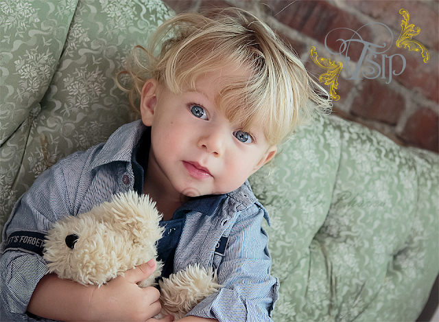 Blue_Eyed_Boy_with_Teddy_Bear