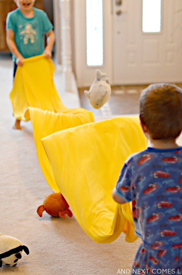 Using a homemade sensory tunnel as a toy trampoline from And Next Comes L
