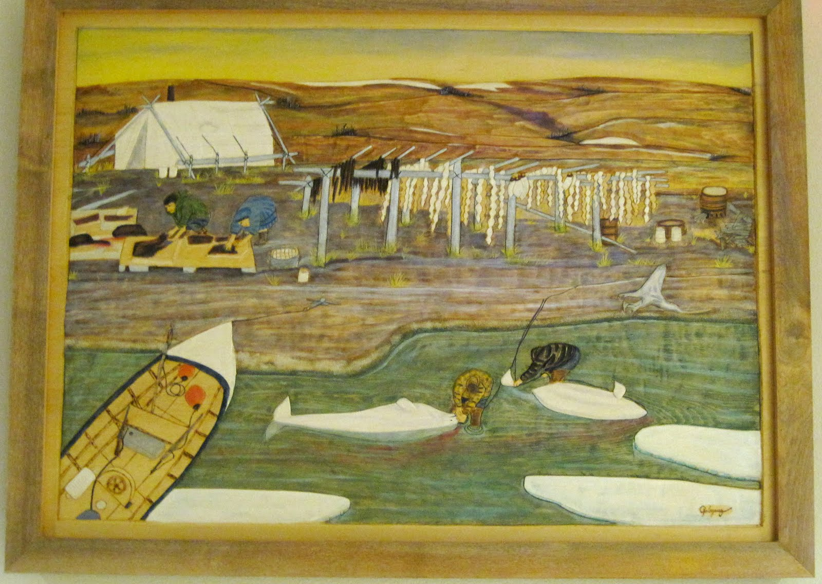 Qalayauq inuit art yellow cedar relief carving for