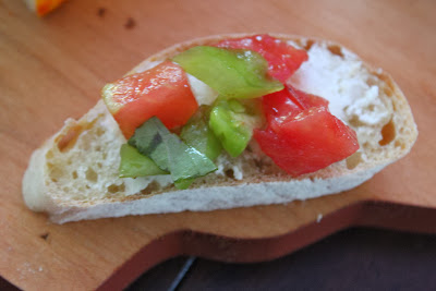 Slice of vegetable demi-baguette with goat cheese and tomatoes