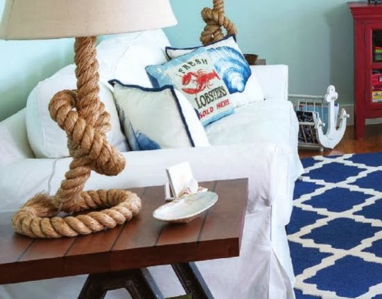 A Casual Living Room With Lots Of Nautical Decorations To Love