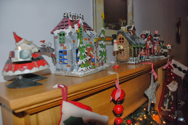 image of Christmas decorations on mantelpiece