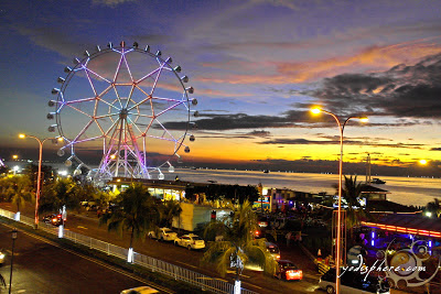 Colorful photo of the giant ferries wheel against the Manila Bay sunset at SM Mall of Asia, San Miguel by the Bay Manila Philippines