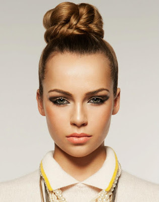 Sleek back style with braided bun. Fashion editorial shoot