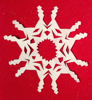 Snipping Six-Point Snowflakes.