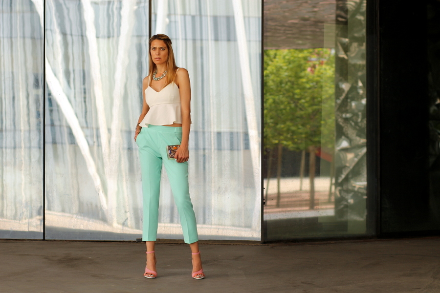Blonde model wearing light green pants