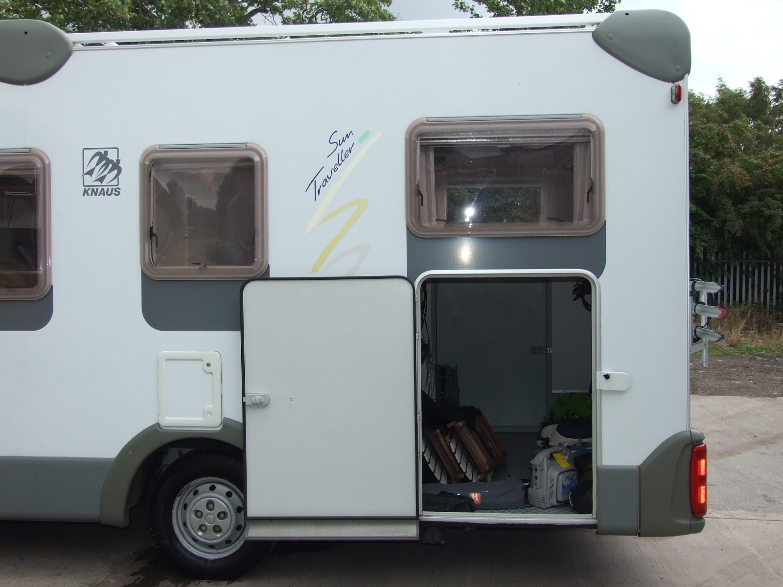 Motorhome with motorcycle garage with creative photos Rv with garage