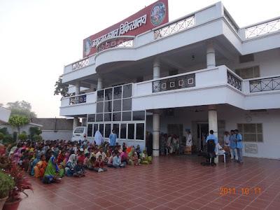 On Sharat Poornima and Jagadguru Kripaluji Maharaj's 90th Birthday, money was distributed to the poor