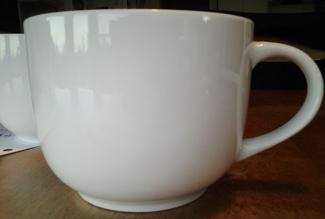 white dollar store mug