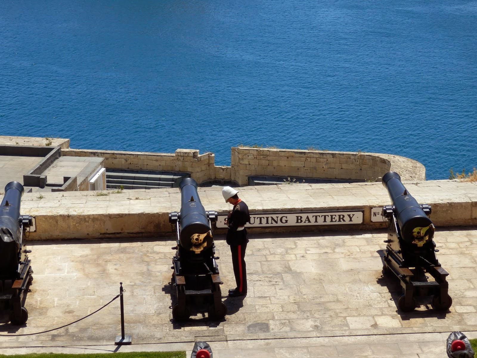 Soldier by cannon at Valletta, Malta