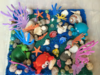 http://funprojectsforyourkids.blogspot.com/2015/05/coral-reef-sensory-bin.html