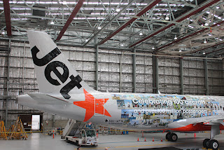 Jetstar's livery features 132 people doing the Jetstar star jump