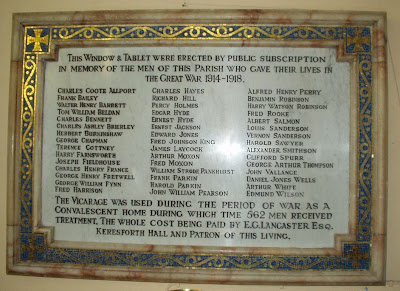 A marble plaque, the border in gold and blue.  Within a dedication and list of names.