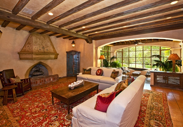 Living room of Mel Gibson's house with red carpeting and lots of wooden work